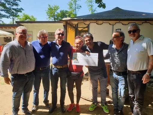 """Garlasco, la band foto di gruppo ha donato una somma di denaro frutto di un concerto di beneficenza all'associazione """"la Chiocciola"""""""